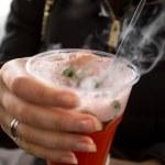 Closeup of woman holding plastic cup with vaporizing fruit tea — Stock Photo #72281305