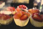 Closeup of fresh strawberry cakes at cafe showcase — Stock Photo