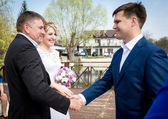 Brides father shaking hands with groom at wedding ceremony — Stock Photo