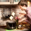 Young man trying to catch toasts popping out of toaster — Stock Photo #75054981