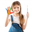 Little artist girl showing painted hands — Stock Photo #75067119