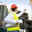 Site manager checking building site under construction — Stock Photo #76616655