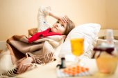 Sick girl with high temperature resting in bed — Stock Photo
