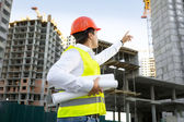 Site manager checking building site under construction — Stock Photo