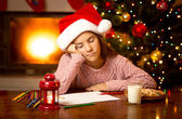 Cute girl fell asleep while writing letter to Santa — Stock Photo