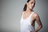 Pretty young female model posing tank top — Stock Photo
