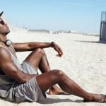 Man sitting on beach relaxing — Stock Photo #53798701