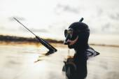 Diver a gun for underwater hunting in a water — Stock Photo
