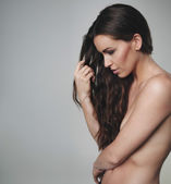 Natural beauty with long hair standing topless — Stock Photo