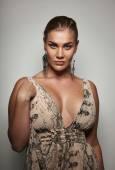 Sensual female model in formal dress posing to camera — Foto de Stock
