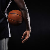Basketball in hand of a young player — Stock Photo