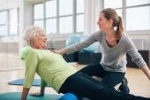 Physical therapist working with a senior woman at rehab — Stock Photo