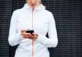 Woman in sportswear using mobile phone — Foto de Stock