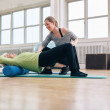 Elder woman doing pilates workout with personal instructor — Stock Photo #63862295