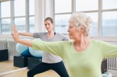Two women doing stretching and aerobics workout — Stock Photo