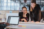 Two young woman working on a new creative design — Stock Photo