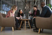 Happy multiracial business people in meeting — Stock Photo