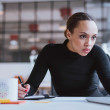 Busy young woman working at her desk — Stock Photo #65658707