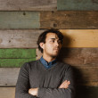 Handsome young business man against a wooden wall — Stock Photo #66297343