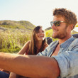 Cheerful young couple on a road trip — Stock Photo #69085767