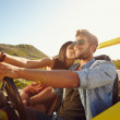 Loving young couple on a road trip — Stock Photo #69085827