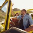 Постер, плакат: Couple having fun on road trip