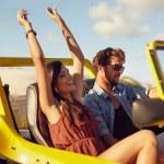 Cheerful young couple enjoying road trip — Stock Photo #69086473