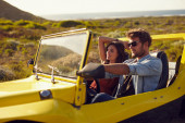 Young  couple on a long drive — Stock Photo