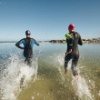 Two athletes competing in a triathlon — Stock Photo #70972203