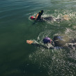 Постер, плакат: Athletes practicing swimming for triathlon race