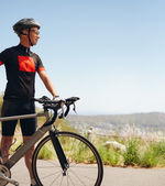 Happy male cyclist on the country side — Stock Photo