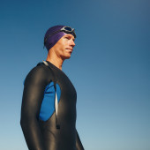 Determined male triathlete in wetsuit — Stock Photo