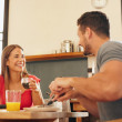 Cheerful young couple having breakfast together — Stock Photo #73197327