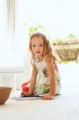 Cute little girl drawing at home — Stock Photo
