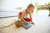 Cute little caucasian girl drawing at home — Stock Photo