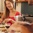 Happy young couple having breakfast together in kitchen — Stock Photo #73665449