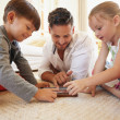 Father and children spending time together using digital tablet — Stock Photo #73666701