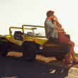 Couple on road trip sharing a romantic kissing — Stock Photo #74126571