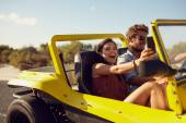 Excited happy couple enjoying on a road trip — Stock Photo