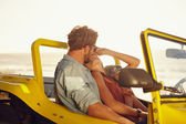 Young couple sharing a romantic moment while on a road trip — Stock Photo