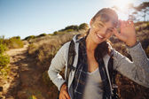 Happy young hiker woman in nature — Stock Photo