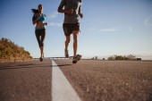 Runners training on country road — Stock Photo