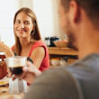 Young couple sitting at breakfast table — Stock Photo #76806243