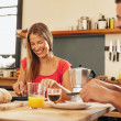 Happy young couple having breakfast together — Stock Photo #76808453