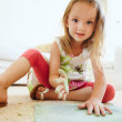 Cute girl drawing sitting on the floor — Stock Photo #80450760