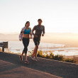 Young couple jogging early in morning — Stock Photo #82168518