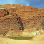Desert Water Hole Beneath Red Rock Cliffs — Stock Photo #57559075