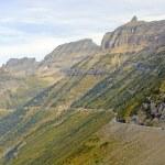 Narrow Winding Road Going up a Mountain Ridge — Stock Photo #73939807