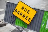 French road barrier with closed street roadsign — Stock Photo