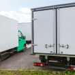 Rear view of new standing white cargo trucks — Stock Photo